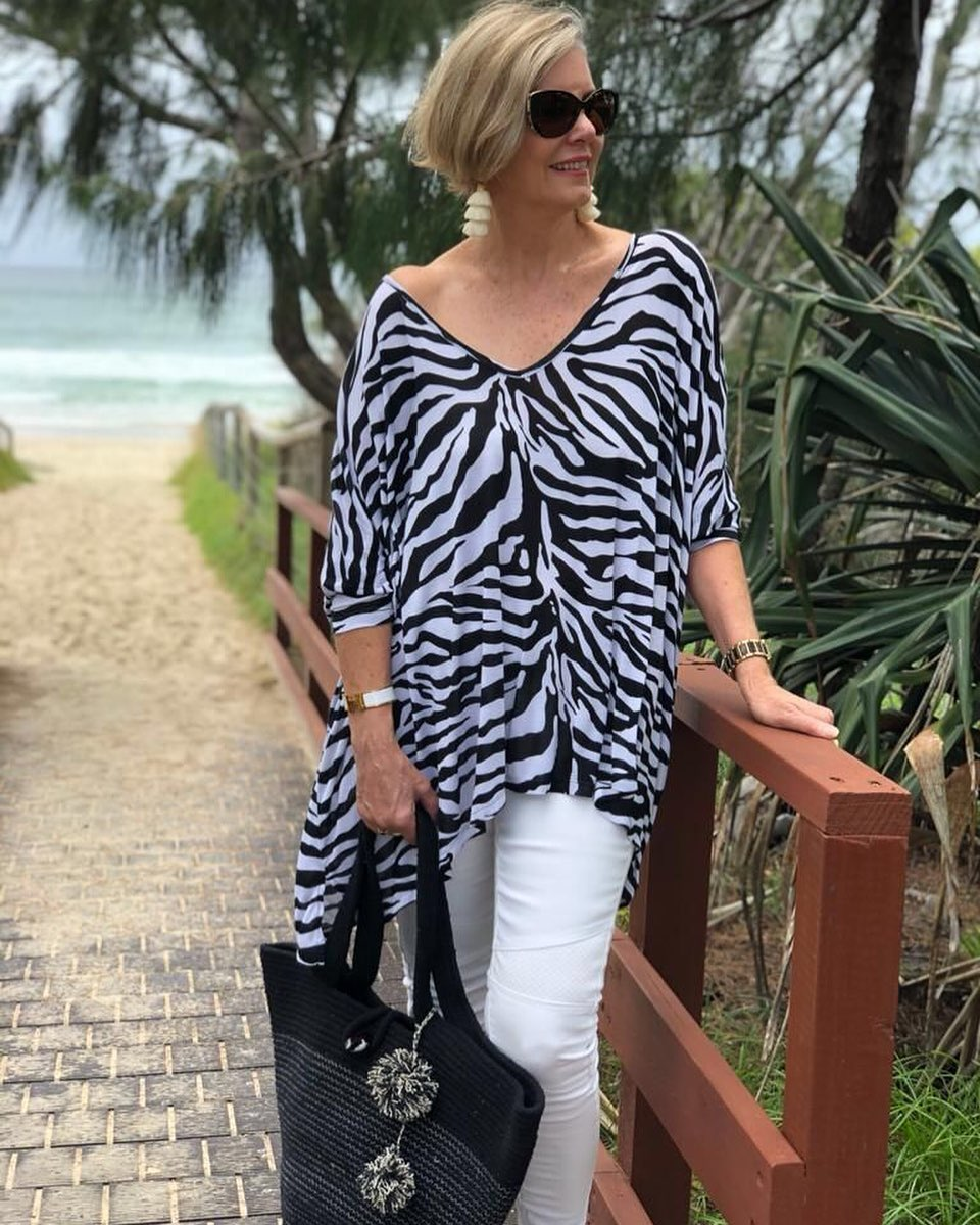 Outfit ideas for ladies 50 and over with animal print blouses