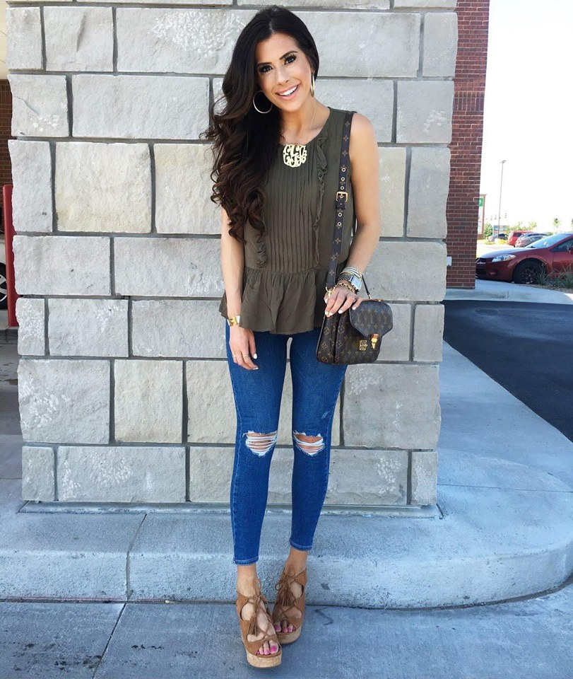 Combination of ripped jean and sleeveless top