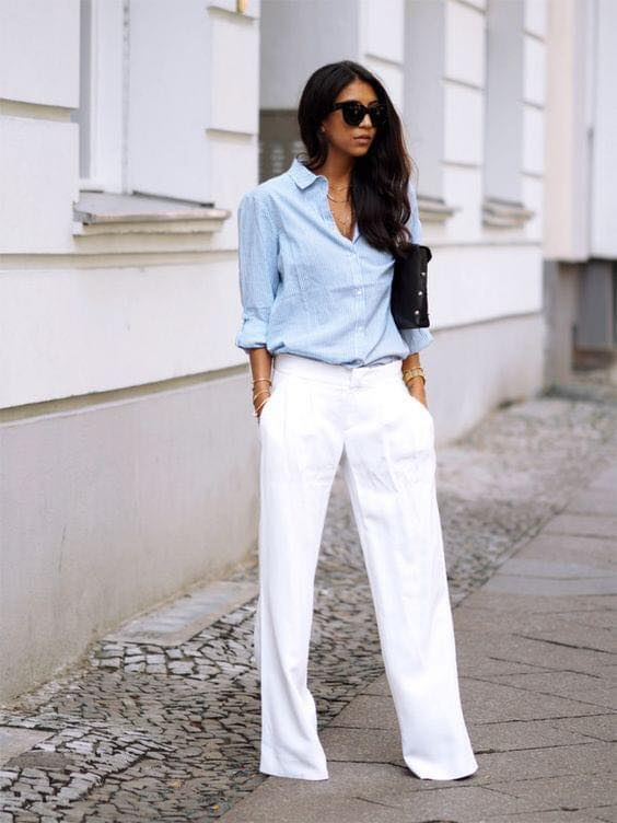 Combination of blue maxi blouse and white dress pants for women 40 years and over
