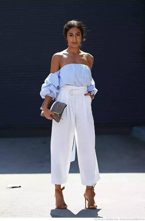 Blue blouse with dropped shoulders and white pants for outfit
