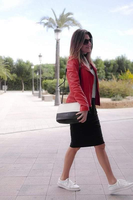 Combine look of red jacket with striped blouse