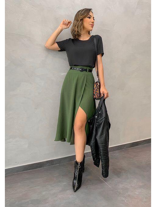 She wears a military green skirt