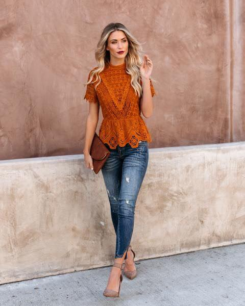 Lace blouse paired with jeans with fall color
