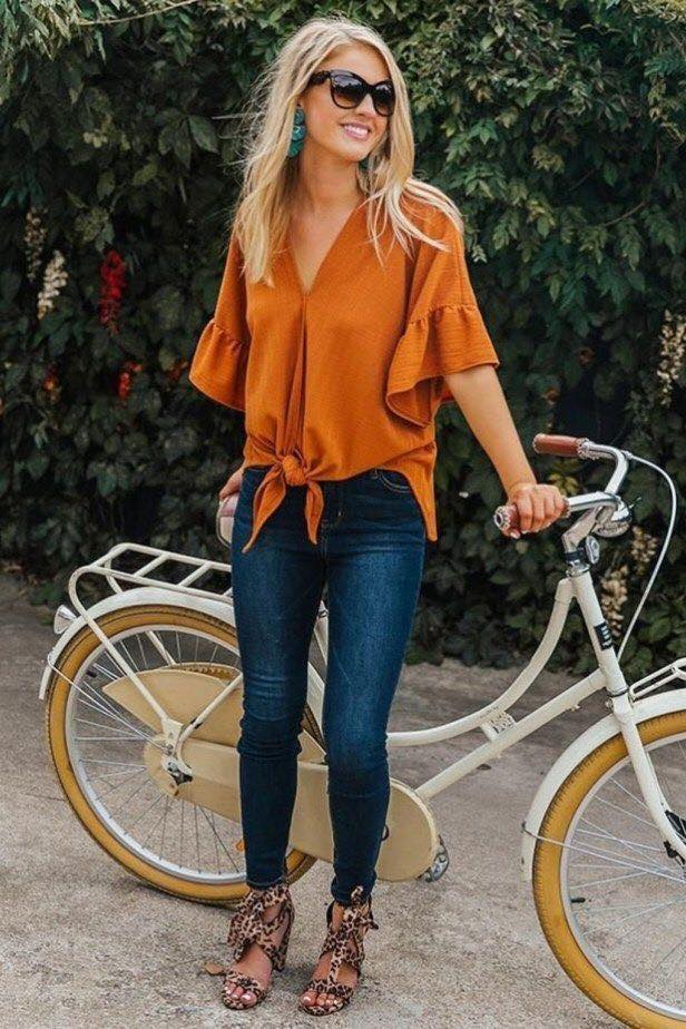 Outfit of blouse with knot in fall color and jeans