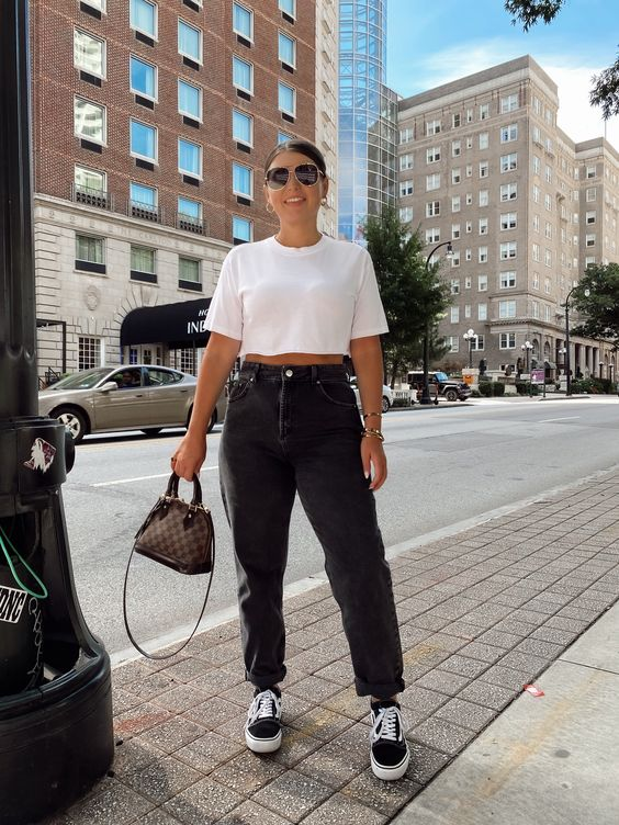 Outfits for mature women with black jeans and tennis shoes