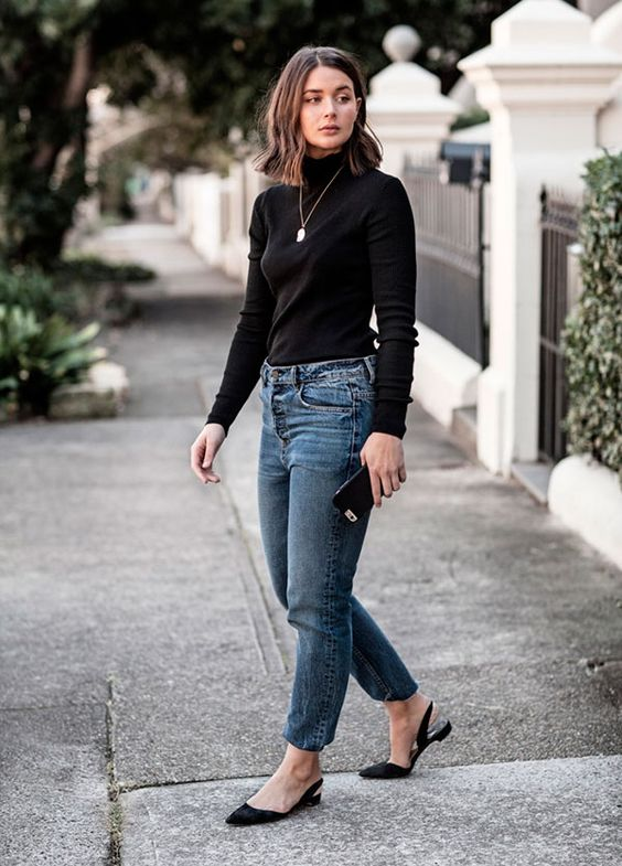 Light jeans combined with dark garments