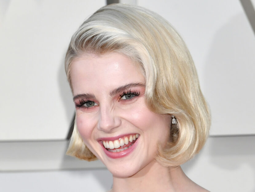Lucy Boynton is light summer and respects her delicacy with a pastel, pink look