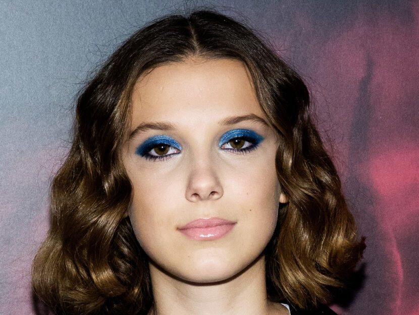 Millie Bobby Brown is cold winter and plays with a pop shade of azure-blue that creates a bellis
