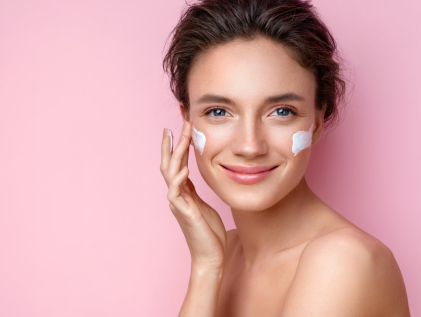 application of the moisturizer on the face with combination skin