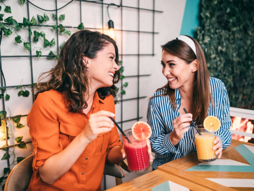 girls drink smoothie that promotes tanning