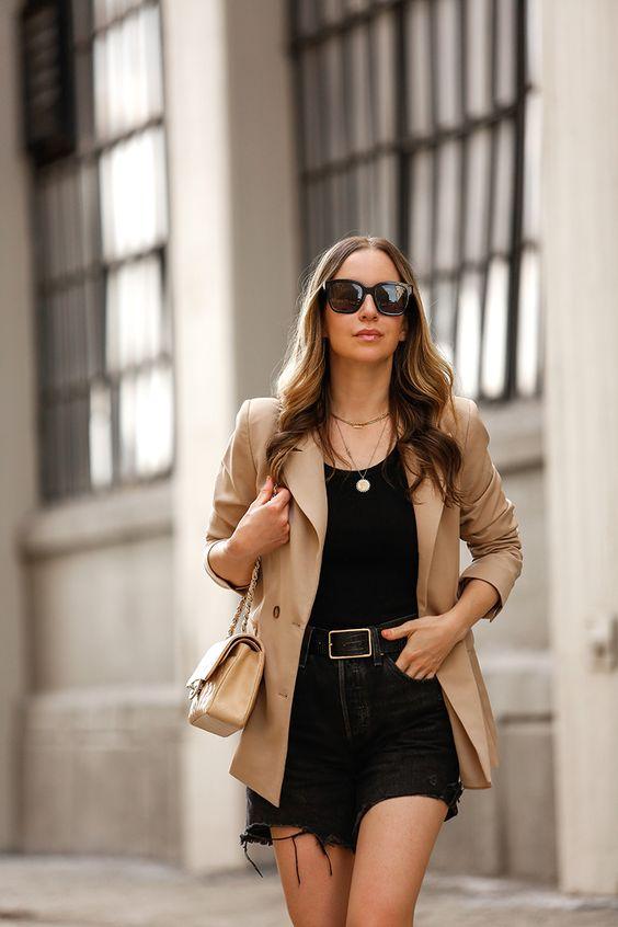 Combine denim shorts with beige blazer