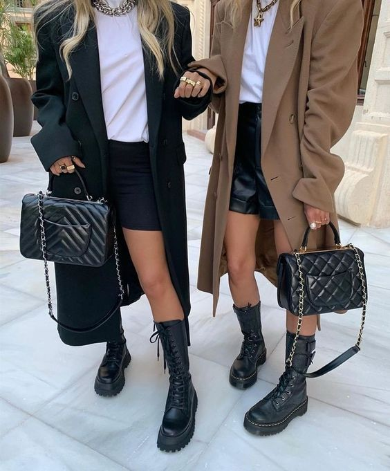 Flat ankle boots with applications