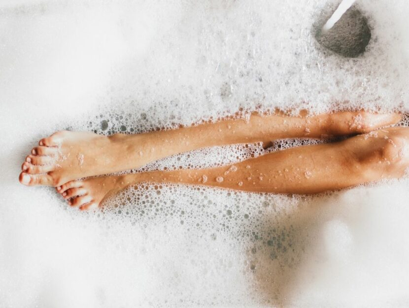 woman with legs in the bath tub